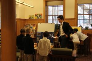An upper school boy giving a presentation in Mandarin class