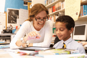 Lower school teacher working with student