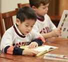 5-year old boys reading books - Fessenden School, MA