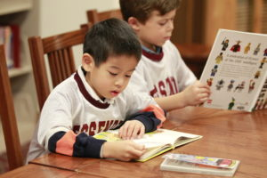 5-year old boys reading books - Fessenden School, MA